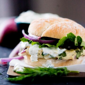 greek turkey burger with tzatziki sauce, red onion, and lettuce