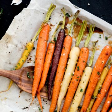 Oven Roasted Brown Sugar Garlic Carrots on baking sheet