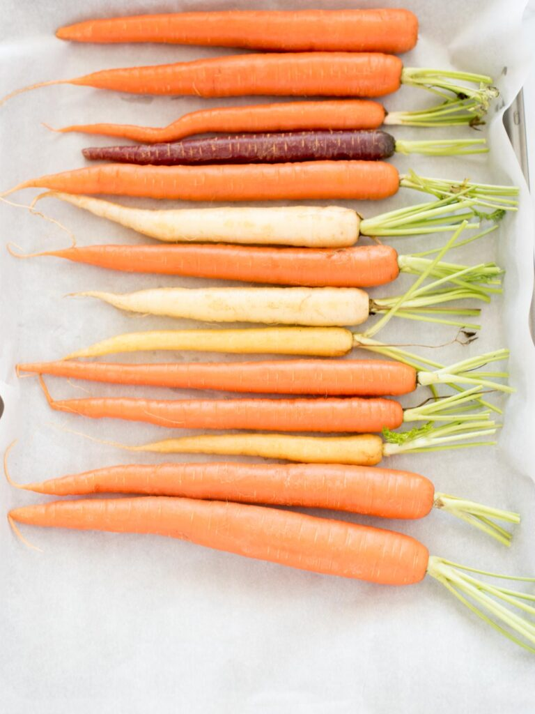 carrots on parchment lined baking sheet