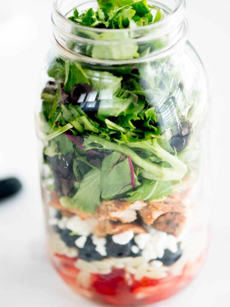 greens added to mason jar with rest of ingredients