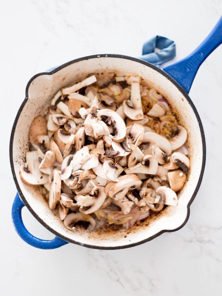 sliced mushrooms in a skillet