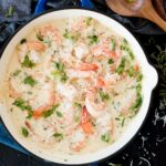 creamy garlic shrimp with parmesan in a blue enamel cast iron skillet