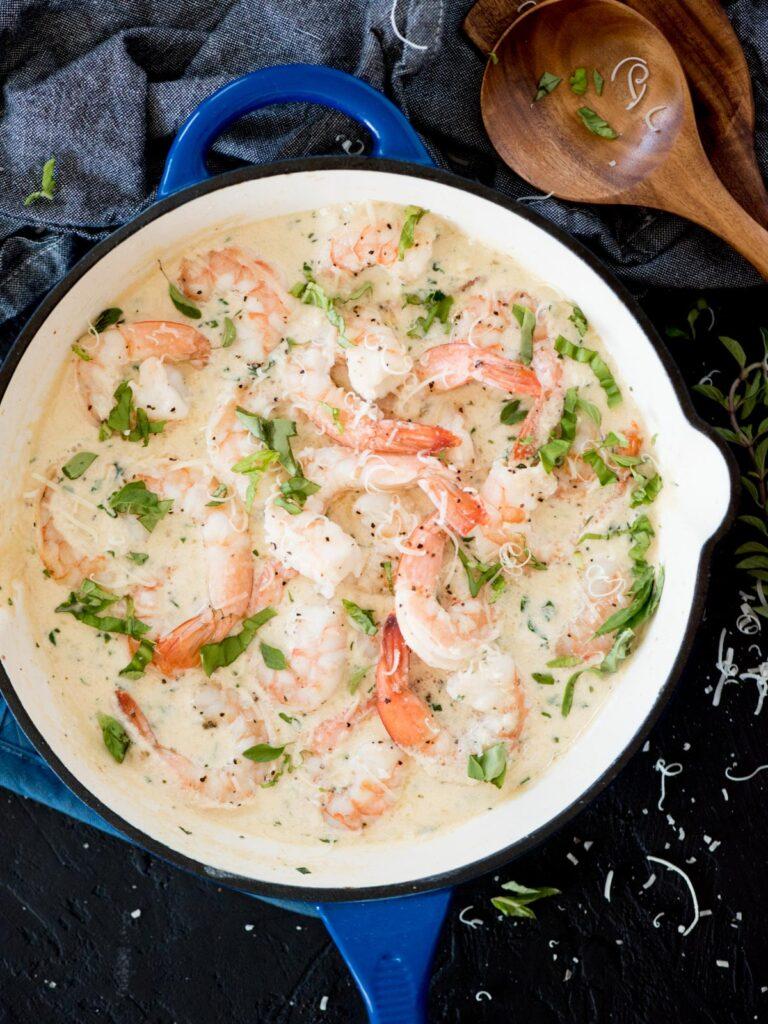 creamy garlic shrimp with parmesan in a blue enamel cast iron skillet
