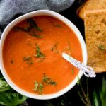 creamy roasted tomato basil soup topped with basil paired with a grilled cheese