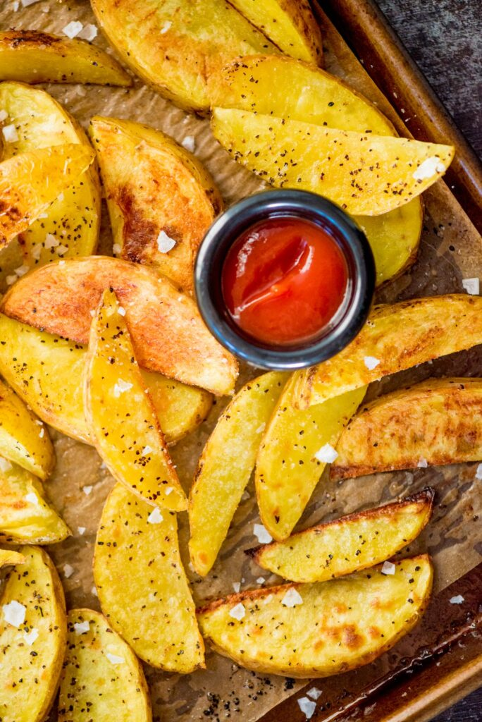 cooked crispy oven baked garlic potato wedges