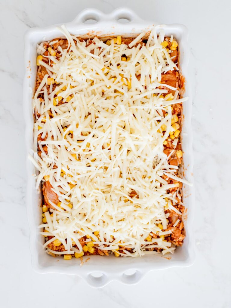 shredded cheese sprinkled over chicken mixture