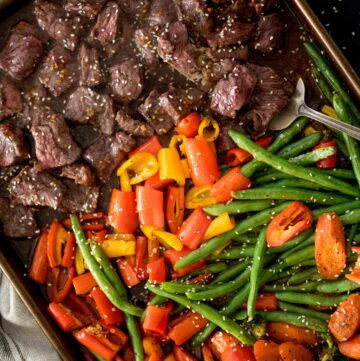 easy sheet pan beef teriyaki cooked on a baking sheet with a serving spoon