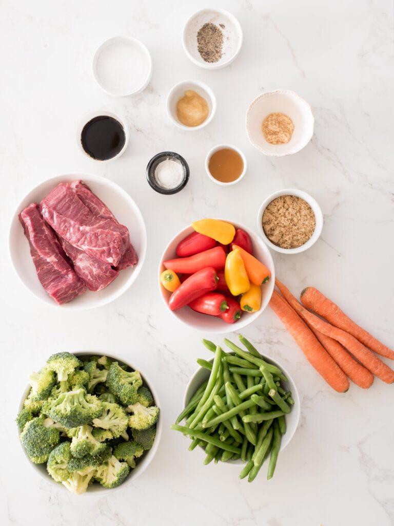 ingredients for easy sheet pan beef teriyaki including vegetables, sauce ingredients, and beef