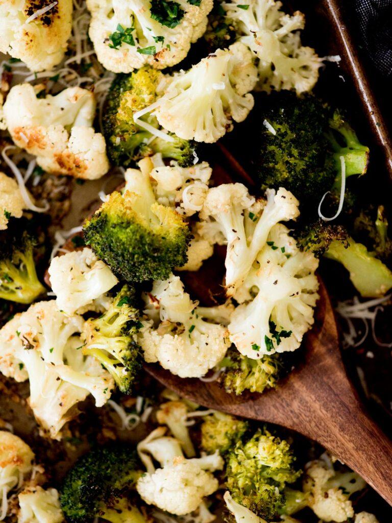 garlic parmesan roasted cauliflower and broccoli on a sheet pan