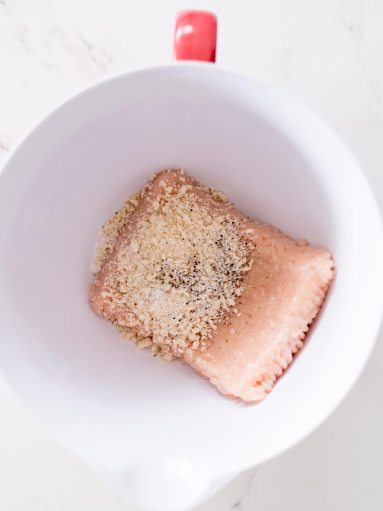 ground chicken, salt, pepper, and panko breadcrumbs in a mixing bowl
