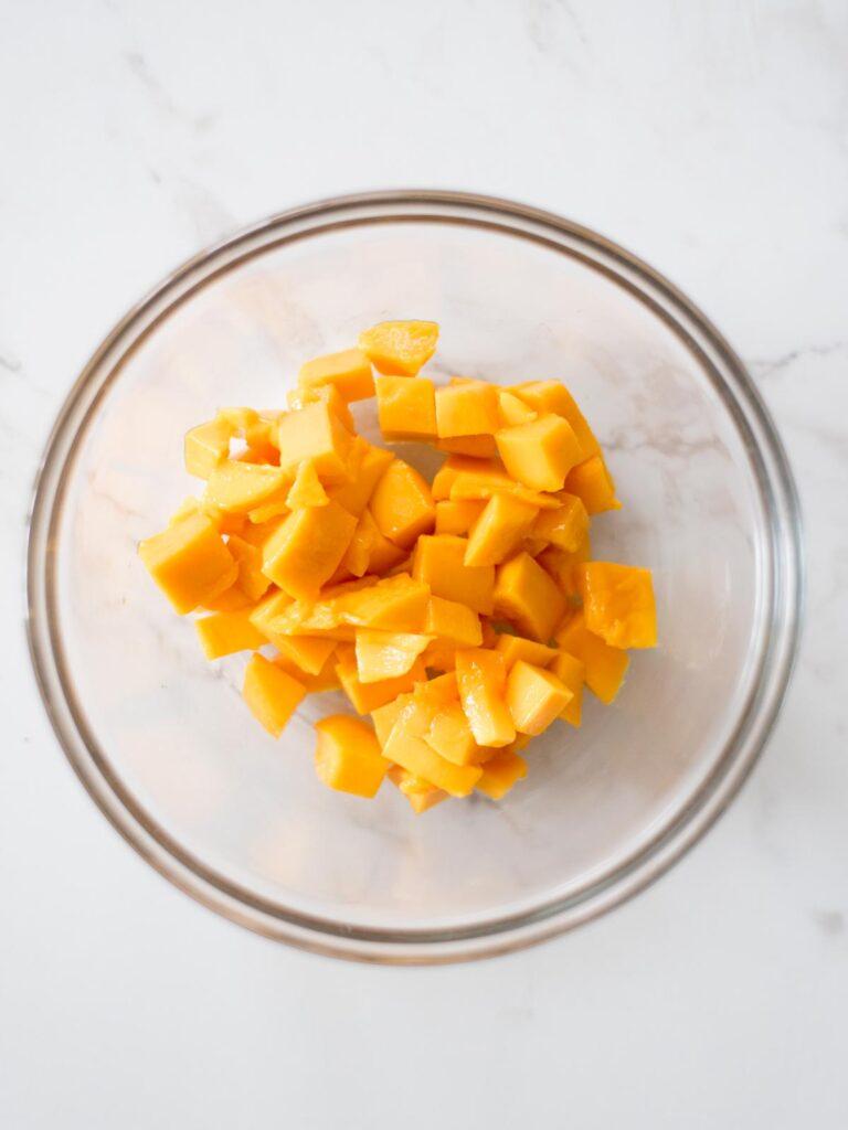 chopped mango in a mixing bowl