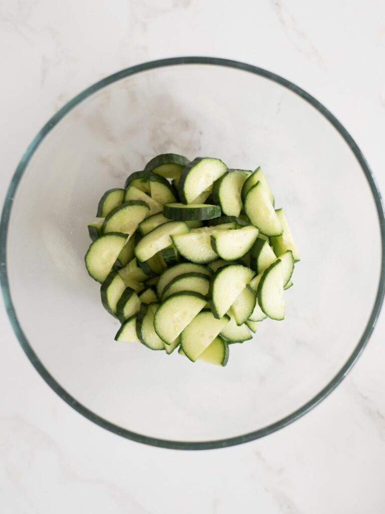 cucumbers added to mixing bowl