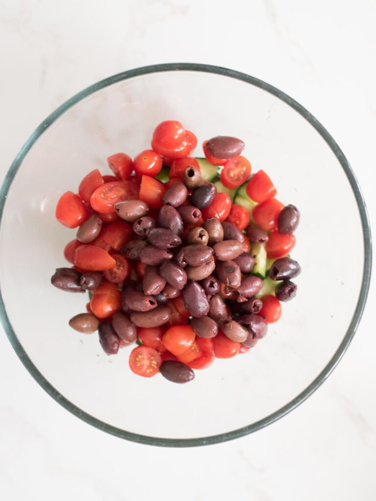 Kalamata olives added to mixing bowl