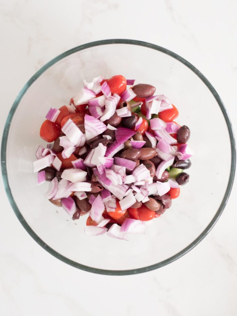 red onion added to mixing bowl