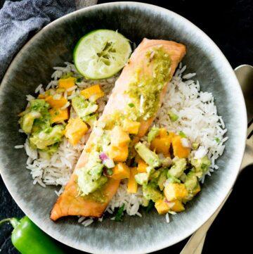 honey jalapeno lime salmon in a bowl with jasmine rice and mango avocado salsa