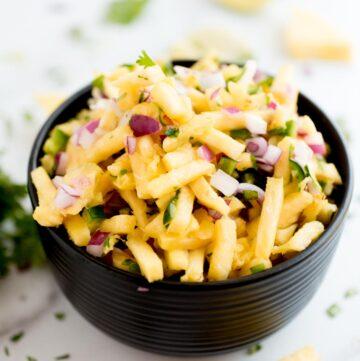 pineapple pico de gallo in a black bowl