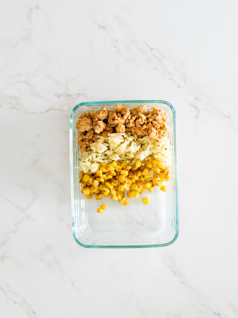 turkey, rice, and corn in glass container