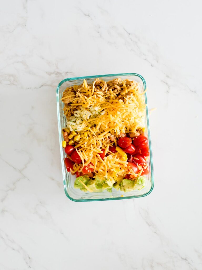 turkey taco bowls in a glass container