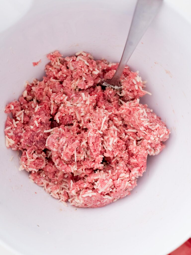 ingredients for cheesy ranch burgers mixed together in a bowl