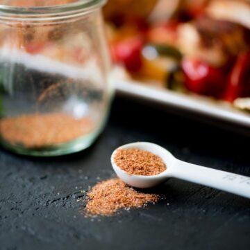 homemade fajita seasoning in a jar and measuring spoon
