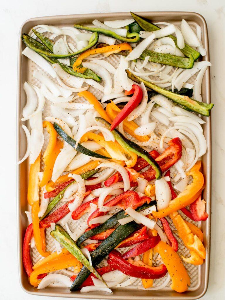 seasoned vegetables on a sheet pan