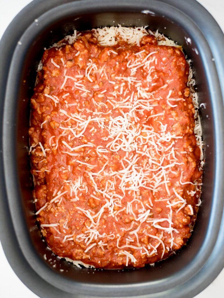 uncooked crockpot lasagna in the slow cooker