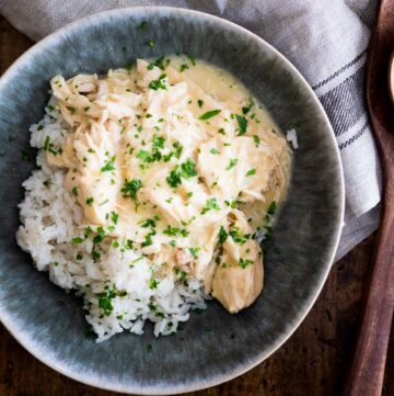crockpot ranch chicken over rice sprinkled with parsley