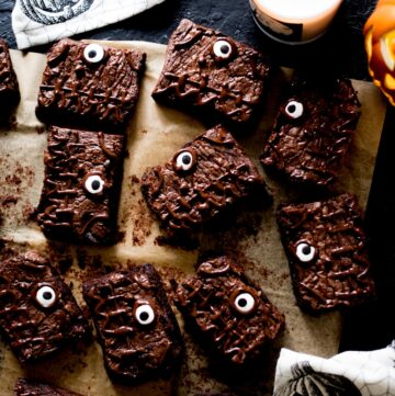 halloween brownies with a candle, towel, and pumpkin